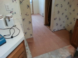clinton twp mi water damaged floor repair & insurance claim 1