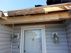 shelby twp mi wind and water damaged doorway overhang repair 1